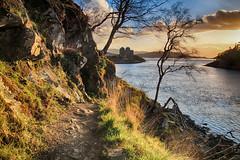 Castle Tioram first glimpse (OutdoorMonkey) Tags: sunset sea cloud evening coast scotland seaside track hiking path walk bluesky hike route coastal coastline seashore moidart castletioram lochmoidart silverpath