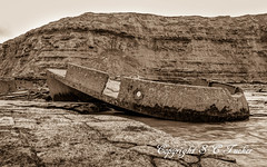 Shipwreck on the Rocks (stephentucker558) Tags: sea sand cliffs shipwreck shore whitby