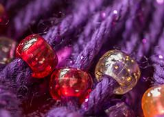 Beads on Scarf (PhotoArtMarie) Tags: orange macro beads purple yarn
