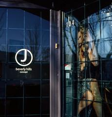 Behind the Windows - Film Rolleiflex (Photo Alan) Tags: street door windows people woman reflection film rolleiflex outside streetphotography inside filmcamera rolleiflex28f filmscan carlzeiss film120 carlzeisstessar80mmf28
