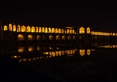 a view of the khaju bridge at night highlighting the arches, Isfahan Province, isfahan, Iran (Eric Lafforgue) Tags: city travel bridge urban reflection building tourism horizontal architecture night buildings outdoors persian asia arch iran middleeast bridges engineering persia arches nobody landmark architectural illuminated civil iranian centralasia esfahan isfahan ispahan    iro isfahanprovince khajubridge  colourpicture  hispahan iran034i3535