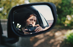 years go by (manyfires) Tags: camera selfportrait film me car analog self 35mm mirror spring photographer bokeh nikonf100