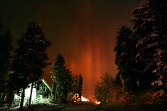 Red Aurora in Lapland by Teresa Cooper (tc2084) Tags: trip travel trees winter red cold green weather finland season photography lights frozen photo cabin freezing astrophotography aurora lapland levi nightsky northern teresacooper