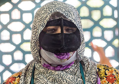 a bandari woman wearing the traditional mask called the burqa on a market, Hormozgan, Bandar Abbas, Iran (Eric Lafforgue) Tags: people woman horizontal outdoors persian clothing asia veil mask iran market muslim islam religion hijab persia headshot hidden covered iranian bazaar adults adultsonly oneperson islamic burqa ethnicity middleeastern frontview persiangulf sunni bandarabbas burka chador balouch hormozgan onewomanonly lookingatcamera burqua   embroidering 1people  iro straitofhormuz  colourpicture  borqe boregheh iran034i1851