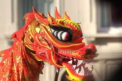 The Dragon was chasing me (Tony Shertila) Tags: city england festival liverpool costume europe chinatown fiesta dragon britain lion chinesenewyear celebration merseyside dra