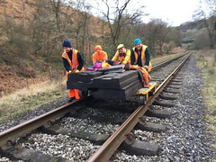 Debbie, Michael, Stephen and Bob push crossing panels near the Grange 1Mar16