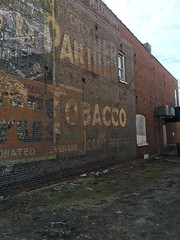 Ghost Signage- De Pere, WI (MichaelSteeber) Tags: building brick wisconsin advertising outside outdoors signage tobacco ghostsign orangecrush pasquales depere labelscar