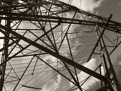 p9 (sloegenie) Tags: blackandwhite pylons electricity dramatic barbedwire industrial steel sky perspective