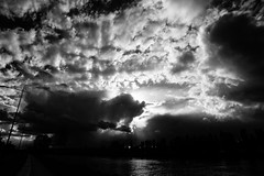Bad Mood Rising (Tom Anirae) Tags: sunset red sky blackandwhite bw sun storm monochrome beauty clouds contrast soleil angle natural noiretblanc wide nb jour filter nikkor nuages contre naturallighting afd 2035 officialnikkor d700