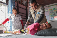 Nirmala laughs during a physiotherapy session with Jay. (Handicap International UK) Tags: nepal handicapinternational ngo prosthesis physiotherapy rehabilitation nepalearthquake