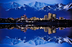 Reflections from downtown Anchorage, Alaska, U.S.A. (Lago Tanganyika) Tags: city longexposure urban usa building alaska architecture skyscraper reflections cosmopolitan downtown cityscape metro dusk anchorage citylights highrise metropolis bluehour metropolitan centralbusinessdistrict nikond90 jorgemolina