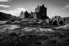 Eileen Donan Castle (jasonmgabriel) Tags: bridge bw white black building castle water monochrome clouds landscape scenery rocks highlander loch eileen donan