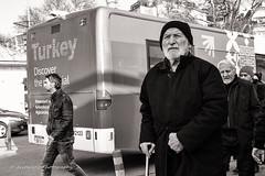 Street 72 (`ARroWCoLT) Tags: street old people bw man bus monochrome sepia photography blackwhite samsung mini istanbul f18 eyeglasses seller sb sokak otobs nx skdar 17mm siyahbeyaz nxm