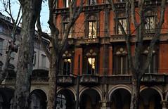 (IlPoliedrico) Tags: old sunset red italy building alberi torino tramonto palazzo portici turin rosso luce riflesso finestre viale riflection