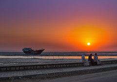men dressed in traditional dress, sitting on a bench in front of a sunset and a dhow boat, Qeshm Island, Laft, Iran (Eric Lafforgue) Tags: wood sunset sea sky people man men beach water horizontal outdoors evening harbor boat fishing marine asia sitting waterfront iran harbour dusk shoreline relaxing peaceful persia east males resting lowtide copyspace fishingboat tranquil adultsonly dhow middleeastern persiangulf robes 3people qeshmisland menonly threepeople laft hormozgan إيران fulllenght иран イラン irão straitofhormuz 伊朗 nauticalvessel unrecognizableperson colourpicture 이란 iran034i8250