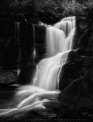 Cedar Rock Falls (johanhakanssonphotography) Tags: longexposure travel camping blackandwhite mountains nature water monochrome beauty sport metal creek forest river print landscape outdoors photography blackwhite waterfall fishing woods education nikon scenery acrylic hiking scenic northcarolina hike falls canvas adventure nationalforest trail backpacking lookingglass environment flyfishing recreation trout blueridgemountains blueridgeparkway pinkbeds brevard protected slidingrock pisgahnationalforest lookingglassrock naturetrails westernnorthcarolina johnrock cedarrockfalls walkingtrails davidsonriver usnationalparkservice southernappalachians cedarrockcreek johnsrock cradleofforestryinamerica pisgahcenterforwildlifeeducation johanhakanssonphotography forestheritagescenicbywayforestdiscoverycenteratcradleofforestry usforestservicerangerstation pisgahnationalforestfishhatchery bobbynsetzerfishhatchery