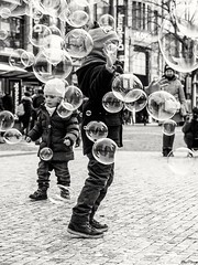 BubbleHunters (Rey//Scue) Tags: life street people urban bw white kids blackwhite outdoor documentary streetlife social traveling bwstreet urbanbw