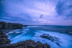 Blue (Hazel Rodrguez) Tags: ocean longexposure travel blue sunset sea sky sun mountains beach colors clouds sunrise landscape nikon rocks natural sigma lanzarote nikkor 1020 canaryislands longexposition