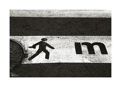 m (ngel mateo) Tags: street blackandwhite man blancoynegro walking calle crossing symbol icon m granada crosswalk manholecover icono hombre paseando cruzando smbolo pasodepeatones tapadealcantarilla ngelmartnmateo ngelmateo pasosannimos stepsanonymous