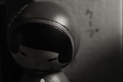 Vintage Nipponese Doll / _1070085 (doug_r) Tags: blackandwhite bw washington nw fremont centeroftheuniverse blancetnoir vintagelens antiquelens blancoynegre panasonicgf1 1070085 20160213 2016dtrosenoffallrightsreserved fremontweekendmarket carlzeissjenasmall50mmf28tessar lrpostprocconv