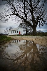 St. Marcus Evangelical Church (Notley) Tags: reflection church wet water architecture clouds rural puddle march outdoor reflect missouri katytrail 2016 10thavenue notley rhinelandmissouri notleyhawkins missouriphotography httpwwwnotleyhawkinscom notleyhawkinsphotography montgomerycountymissouri stmarcusevangelicalchurch
