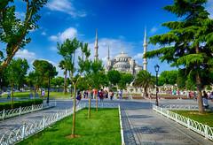Sultanahmet Square in Istanbul, Turkey (` Toshio ') Tags: park trees sky clouds turkey path islam religion istanbul bluemosque minarets toshio ahmedi sultanahmedmosque sultanahmetsquare xe2 fujixe2