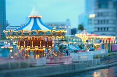 Minatomirai (Yuri Figuenick) Tags: blue light art yellow japan fairytale night lensbaby evening focus bokeh amusementpark dreamy yokohama merrygoround minatomirai tiltshifted canoneos5dmarkiii edge80