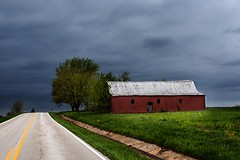 Standing Before the Storm (Jon Dickson Photography) Tags: road red storm abandoned clouds farmhouse barn dark cloudy country stormy missouri interstate decrepit