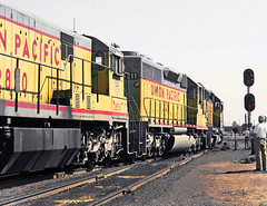 Union Pacific engines EMD SD40-2 # 8065, EMD SD40-2 # 3211 & GE U30C # 2850, part of a 5 locomotive set, is leading a manifest freight train through a turnout to the main line in Colorado, Summer 1980 - 1 (alcomike43) Tags: old people color classic up vintage ties switch photo colorado tracks photographers trains historic negative photograph engines rails unionpacific freighttrains ge spikes engineer locomotives railroads ballast rightofway dieselengine turnout mainline emd sd402 3211 passengertrains roadbed diesellocomotive 2850 railfans 8065 diesels dieselelectriclocomotive u30c blocksignal tieplates anglebars conventionaljointedsectionrail manifestfreighttrain railfanexcursiontrain