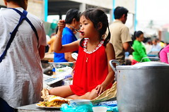 ,, Child, Laos ,, (Jon in Thailand) Tags: street pink blue red green girl breakfast nikon asia child teal streetphotography spoon pigtails nikkor laos cookingpot d300 morningmarket 175528 lpdr childeating viangchanlaos