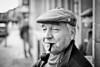 James #229 (drmaccon) Tags: old man hat cool eyes fuji glasgow leicester pipe streetportrait cap gaze flatcap olderman pipesmoker smokingpipe blackandwhiteportrait 100strangers xe2