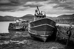 (MacBorow) Tags: county travel ireland sea sky blackandwhite bw irish detail nature clouds contrast canon landscape boat fishing dock ship harbour tide dramatic louth peer