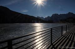 winter light (Fay2603) Tags: winter light sun lake mountains reflection ice nature fence seasons