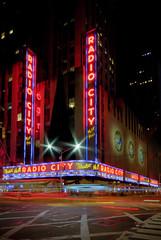 Radio City (Tom Farrow) Tags: street new city nyc pink light urban music holiday motion blur colour cars car yellow night radio nbc hall concert traffic cab taxi ciudad landmark your commission preservation rockettes nyclpc