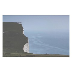 A scene by the sea. (3amfromkyoto) Tags: sea people seascape square coast scene cliffs squareformat sevensisters eastsussex stuartlee 3amfromkyoto iphoneography instagramapp uploaded:by=instagram thiswasnothere