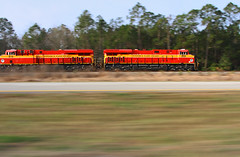 Flyin along Highway 1 (Moffat Road) Tags: railroad blur train florida champion highway1 magnolia locomotive fl ge pacing bayard 226 dixiehighway fec ushighway1 floridaeastcoast intermodaltrain es44c4 newlocomotives