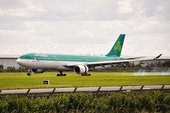 a330 Landing (Dave Goes on an Adventure) Tags: airport airbus aerlingus a330 airbusa330 runway green ireland dublin see feel do touch sense expierence more tour trek treck wander wonder wonderlust wanderlust flickr digital location life capture captured moment real people