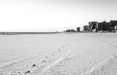 wonder where he went... (-gregg-) Tags: ocean sky bw beach water foot sand prints hotels