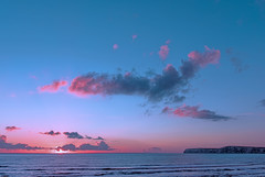 Pink Sea Sunset (Simon Downham) Tags: blue sunset sea cloud sun seascape water beauty landscape grey coast waves pastel horizon gray floating peaceful tranquility wave 2006 calm pastels suspended february float scape tranquil twighlight dsc50232