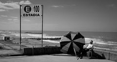 Estada (Fer Gonzalez 2.8) Tags: street sea people beach umbrella blackwhite chair seat sunday 100 easy signal sunnyday monocrhome noparkingsignal leicadlux4 bigskyies