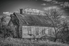 Another Era (Doug Wallick) Tags: old school windows house west minnesota rural town hall over weathered shack grown boarded delano highway12