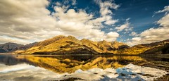 What a difference a day makes. (AlbOst) Tags: mountains reflections lochs eveninglight scottishhighlands lochduich coth mountainranges scottishmountains thefivesisters thefivesistersofkintail coth5