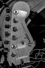 famous headstock (gdajewski) Tags: bw closeup guitar flash fender strat speedlight fenderstratocaster electricguitar musicinstrument nikkor1855mmf3556 r1c1 macroflash nikond7000 dajewski gdajewski