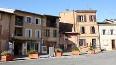 Lombez, France (john shortland) Tags: street houses france building terracotta shutters gers lombez