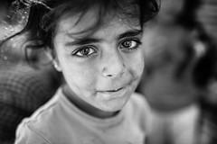 Syrian little girl in Tal Abyad (Giulio Magnifico) Tags: street portrait beautiful closeup turkey children hope blackwhite nikon child refugees muslim border sigma arabic soul syria emotions isis soulful reportage determination syrian kurdish kurds nikond800e sigma35mmf14art da3sh