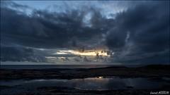 5H48 (Laurent Asselin) Tags: mer soleil eau ciel nuage nuages paysage plage rochers kourou aube ocan guyane