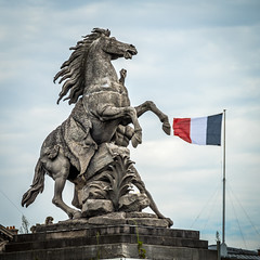 Rearing Horse (Serendigity) Tags: city horse paris france tower statue flag