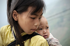 Baby on the back of her sister in H Giang province - Vietnam (PascalBo) Tags: boy people baby girl outdoors kid nikon asia southeastasia vietnamese child outdoor vietnam asie enfant fille bb indigenous garon d300 vitnam vitnam hagiang asiedusudest hgiang pascalboegli