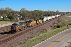 Having already caught the CNW heritage when it came through KC the first time I didn't keep track of it after that and one day while out we get a nice consist on UP-MDMHN with EX SP, UP, CNW seen here passing through Topeka, KS (MrRailfan) Tags: railroad heritage up train pacific ks union rr southern sp kansas topeka ge freight emd cnw