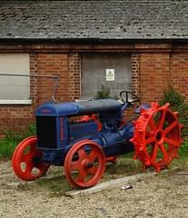 Orange Wheels2 (jonmurphy2013) Tags: tractor colorblue oldtractor bodypainted colororange metalwheels bluetractor notires orangewheels fourwheeledvehicle bodypaintedblue wheelspaintedorange